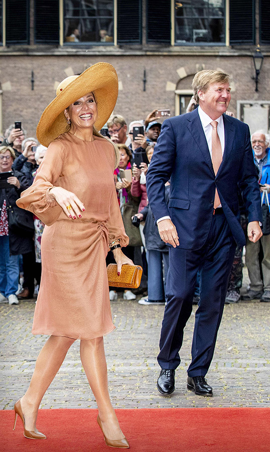 Famous for her hat collection, <strong>Queen Máxima</strong> wore a lovely wide-brimmed number, which perfectly matched her beige dress and heels. She and her husband were attending the celebrations of 100 years general voting rights in the Ridderzaal on May 17.