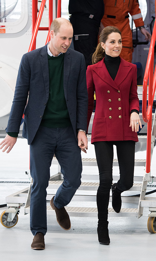 For a day out in Wales on May 8, <strong>Duchess Kate</strong> looked to some old favourites – her red double-breasted Philosophy blazer, black jeans, suede knee-high boots and a black turtleneck. She styled her hair up in a ponytail.