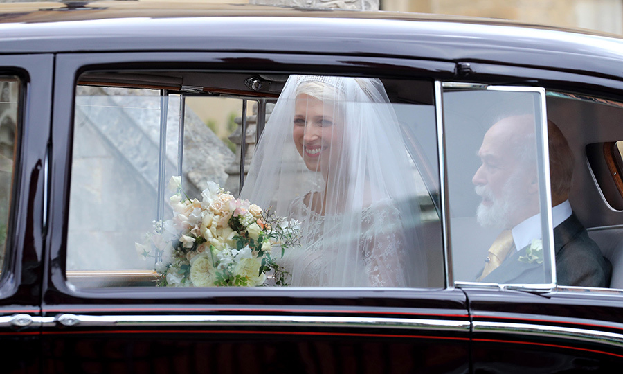 The bride was beaming as she arrived. Look at that smile!