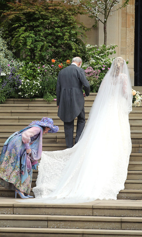 Here's a look at her dress and veil's long train!