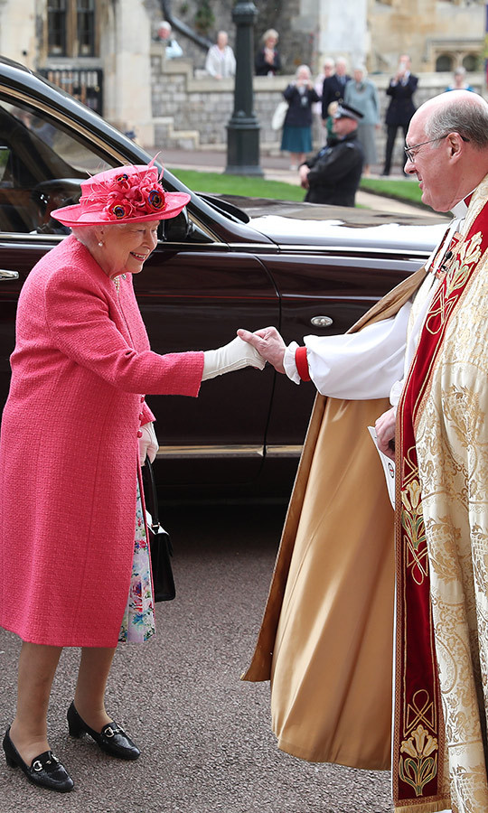 "<a href=""/tags/0/queen-elizabeth-ii""><strong>The Queen</a></strong> looked pretty in pink as she arrived, and shook hands with the Dean of Windsor, Rev. David Conner. This is Her Majesty's third royal wedding in a year!