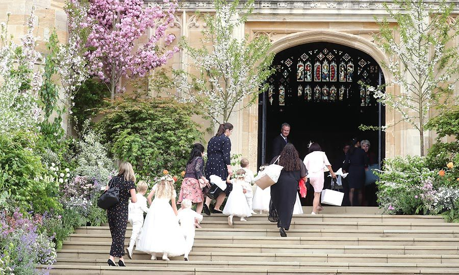 There appeared to be an adorable bit of bustle as guests gathered the bridesmaids and page boys to head into the chapel.