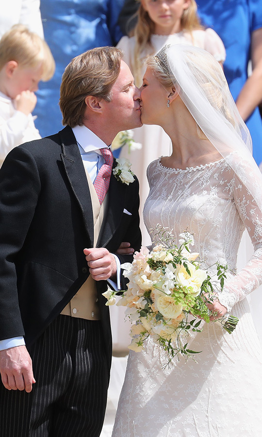 The bride and groom shared a lovely kiss after the ceremony. 