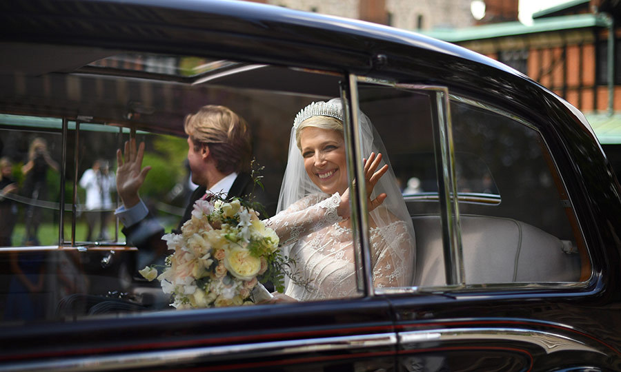 Just married! The newlyweds looked incredibly happy as they waved goodbye to their guests.