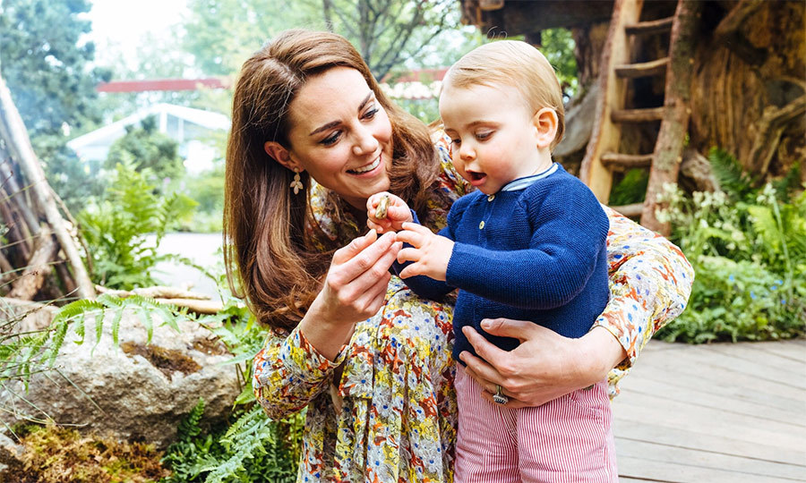 Kate also seems incredibly proud of her youngest child! Here she is showing him something from the garden. He seems fascinated, and we love that Kate's love of nature is being instilled so early in him!