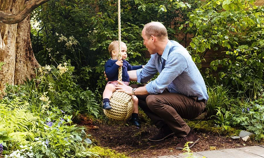 Prince William sweetly helped Louis get comfortable on the swing. Aww!