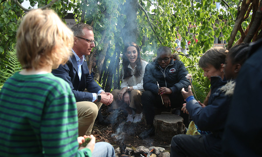 Kate and the children were joined by <strong>Andree Davies</strong> (right) and <strong>Adam White</strong> while roasting marshmallows. Adam and Andree are the two Royal Horticultural Society landscape artists Kate worked with on the garden for the last few months. 