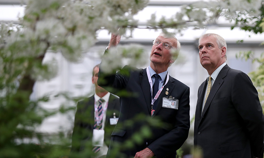"Beatrice's dad, <strong><a href=""/tags/0/prince-andrew"">Prince Andrew</a></strong> (right) was keen to check out many of the fantastic blooms and plants at the show.