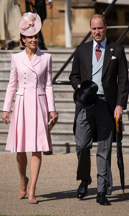 For the sunny day at Buckingham Palace, the Duchess of Cambridge looked no further than her favourite designer, Alexander McQueen, for the beautiful powder pink number. She paired the double-breasted dress with a matching fascinator and a pair of beige suede pumps.