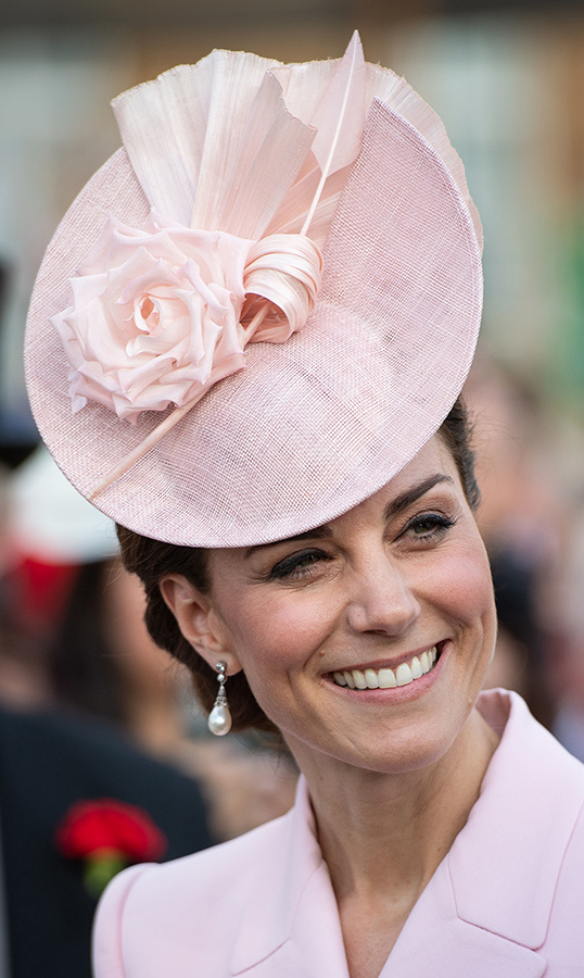 Kate's hat of choice featured a beautiful rose. She went with a pair of pearl and diamond drop earrings, keeping her makeup minimal with some blush on her cheeks.