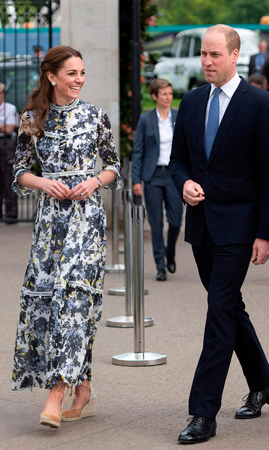 "The <a href=""/tags/0/prince-william""><strong>Duke</a></strong> and <strong><a href=""/tags/0/kate-middleton"">Duchess of Cambridge</a></strong> visited the 2019 RHS Chelsea Flower Show in London on May 20, and Kate looked stunning for the occasion! She dazzled in a floral Erdem gown, anchoring the look with a pair of beige espadrille shoes.