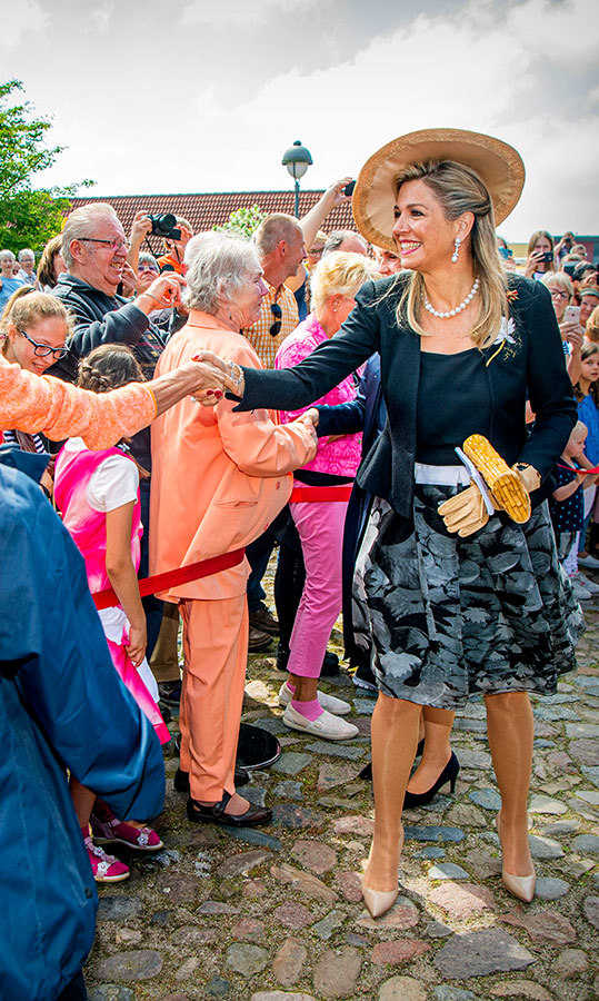 "On May 21, <strong><a href=""/tags/0/queen-maxima"">Queen Máxima</a></strong> visited the cultural market centre Die Scheme in Germany wearing a black-and-grey outfit, paired with beige pumps and a wide-brimmed hat.