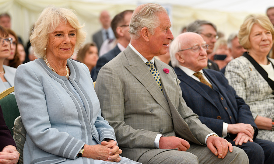 The Duchess of Cornwall watched a performance happily, sitting beside her husband, Prince Charles.