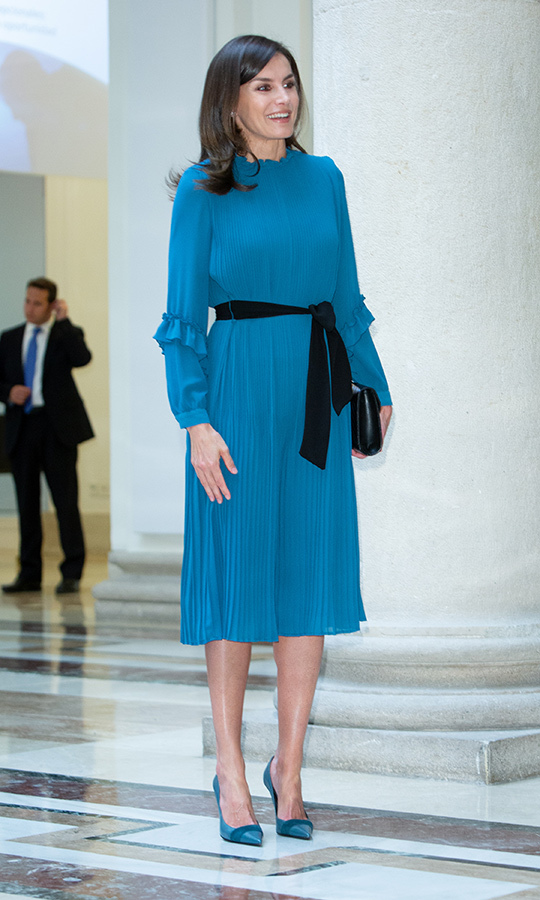 "A beauty in blue! <a href=""/tags/0/queen-letizia""><strong>Queen Letizia</strong></a> stunned in a beautiful pleated blue dress, pairing the look with matching heels and a small black clutch on May 23.