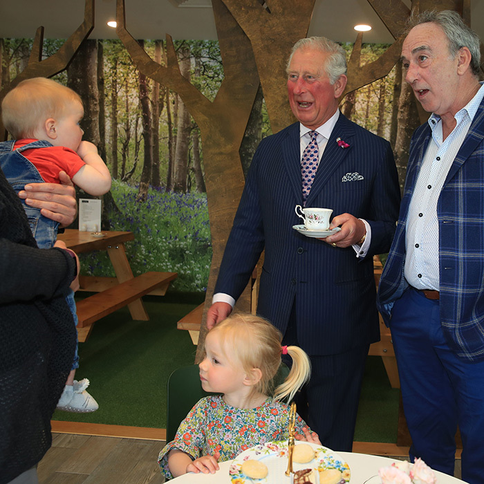 What a cutie! The future King met 9-month-old Margot Dixon, Esme Dixon, 2, and Denis Lynn at the Finnebrogue Artisan event.