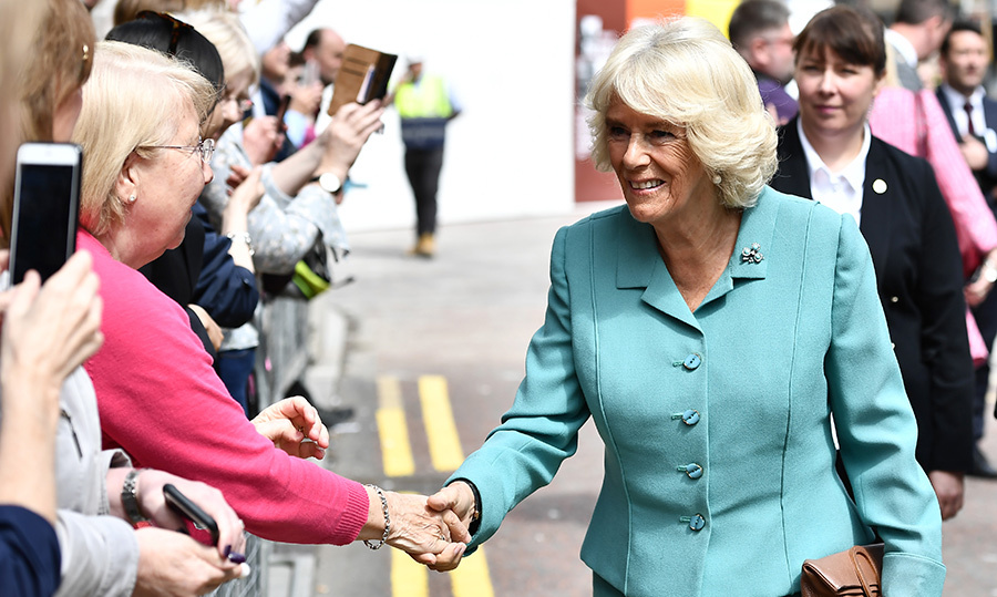 Camilla, Duchess Of Cornwall shook hands with an excited well-wisher during a walkabout in Belfast. The two visited the Primark store following the blaze which destroyed the iconic building last August.