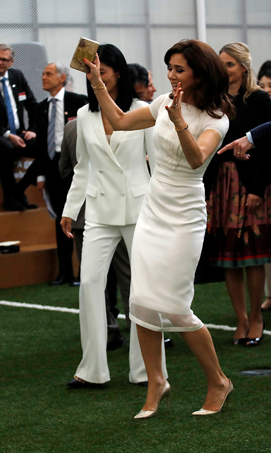 The Crown Princess Mary of Denmark attended the opening reception of Asger Jorn Exhibition at National Museum of Modern and Contemporary Art in Seoul, South Korea. She played a game of three-sided football, looking beautiful in a white dress and matching pumps.