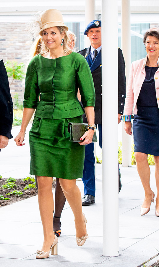 "We're green with envy over this outfit! Earlier that day, <a href=""/tags/0/queen-maxima""><strong>Máxima</strong></a>  stunned in green taffeta dress. The queen was attending the opening of the elderly care house Hof van Nassau in Steenbergen.