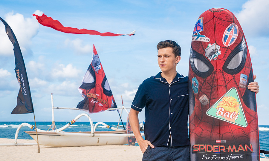 "It was a beach day for <a href=""/tags/0/tom-holland""><strong>Tom Holland</strong></a>! The actor posed with a Spiderman-themed surfboard to promote his new film, <em>Spider-Man: Far From Home</em> during the Pan-Asian Media Summit Bali on May 28.