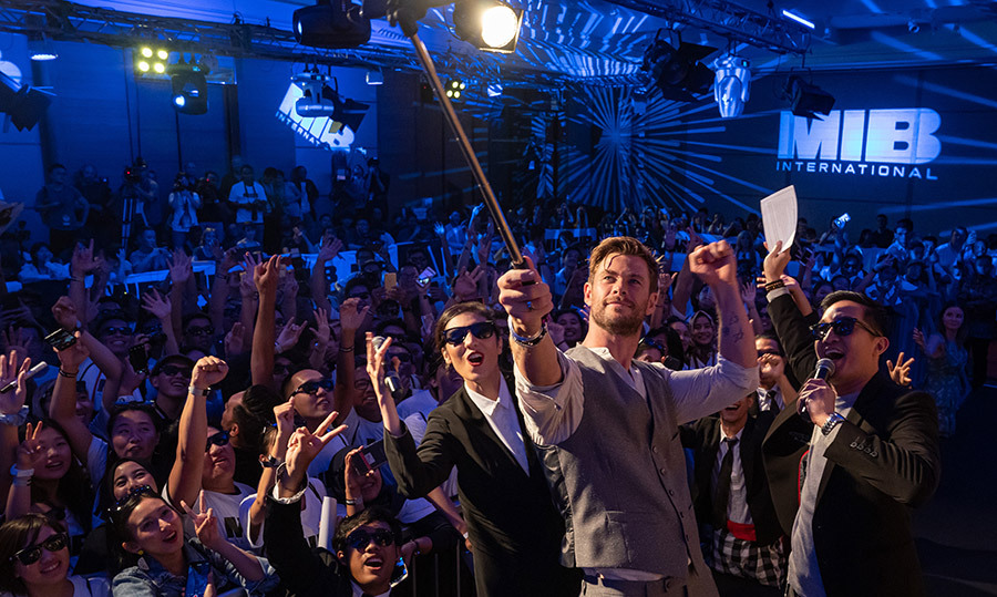 "Stop, drop and selfie! <a href=""/tags/0/chris-hemsworth""><strong>Chris Hemsworth</strong></a> grabbed a fan's selfie stick to snap a quick photo at the <em>Men in Black: International</em> photocall in Indonesia.