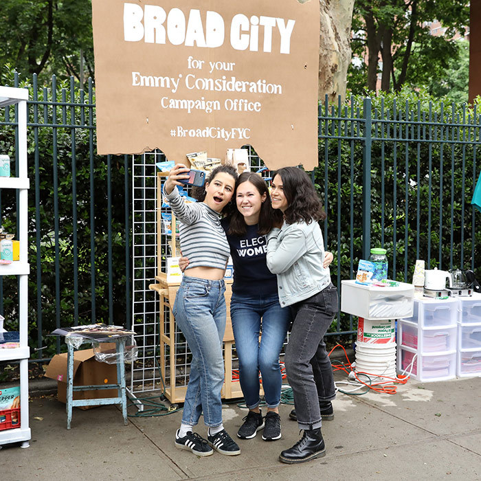 "<em>Broad City</em>'s Ilana Glazer and Abbi Jacobson posed with a fan as they set up FYC campaign headquarters at the ""SHEWORK"" pop up on May 28.
