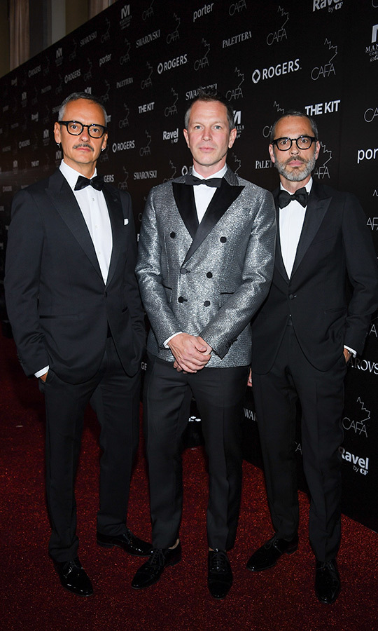 Quebec designer <strong>Thierry-Maxime Loriot</strong> (centre) was given the Vanguard Award by designers <strong>Viktor & Rolf</strong> (left and right). 