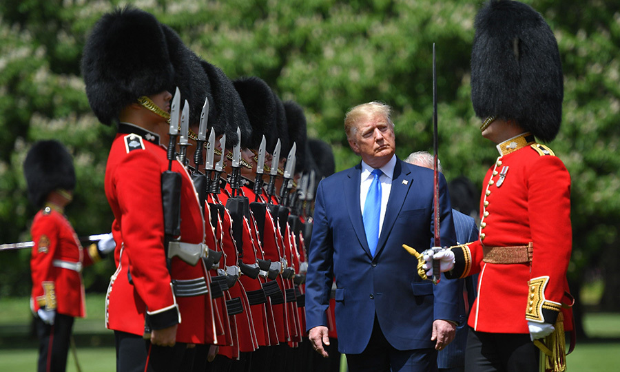 Donald inspected a ceremonial honour guard that greeted him before heading in to the Palace. 