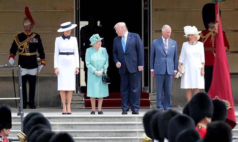 Donald leaned over to say something to Her Majesty while the guards welcomed him.