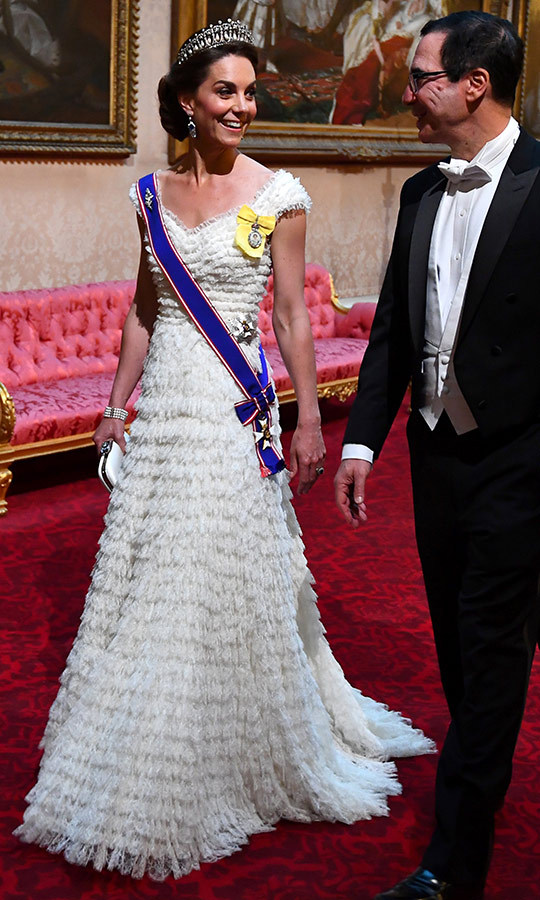 Kate looked absolutely stunning in a white Alexander McQueen dress, which accessorized with the Cambridge Lover's Knot tiara and the Queen Mother's diamond and sapphire fringe earrings. She arrived with US Secretary of the Treasury <strong>Steve Mnuchin</strong>.
