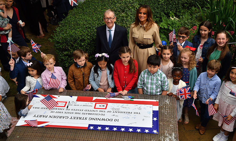 While Donald was in a business meeting with Theresa, Melania and Philip went to a special garden party at 10 Downing Street with many children. 