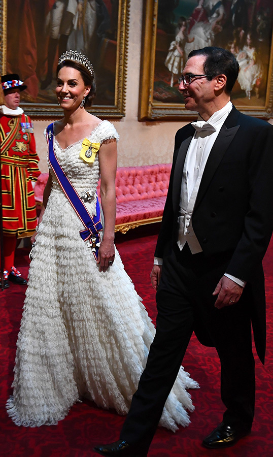 "The <a href=""/tags/0/kate-middleton""><strong>Duchess of Cambridge</strong></a> dazzled in an ethereal white Alexander McQueen gown as she arrived at the Banquet alongside United States Secretary of the Treasury, Steven Mnuchin.