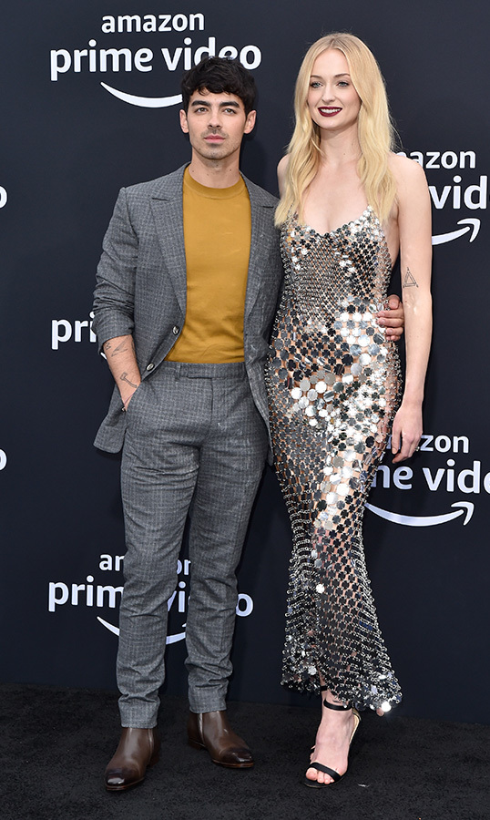 "Newlyweds <a href=""/tags/0/joe-jonas""><strong>Joe Jonas</strong></a> and <a href=""/tags/0/sophie-turner""><strong>Sophie Turner</strong></a> dazzled on the black carpet while attending the premiere of Amazon Prime Video's <em>Chasing Happiness</em> on June 3. The <em>Game of Thrones</em> star stunned in a silver metallic dress for the occasion.