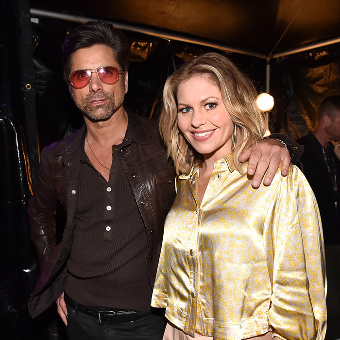 "It was a <em>Full House</em> at the 2019 iHeartRadio awards! <a href=""/tags/0/john-stamos""<strong>John Stamos</strong></a> and Candace Cameron-Bure stopped for a quick snap together backstage.