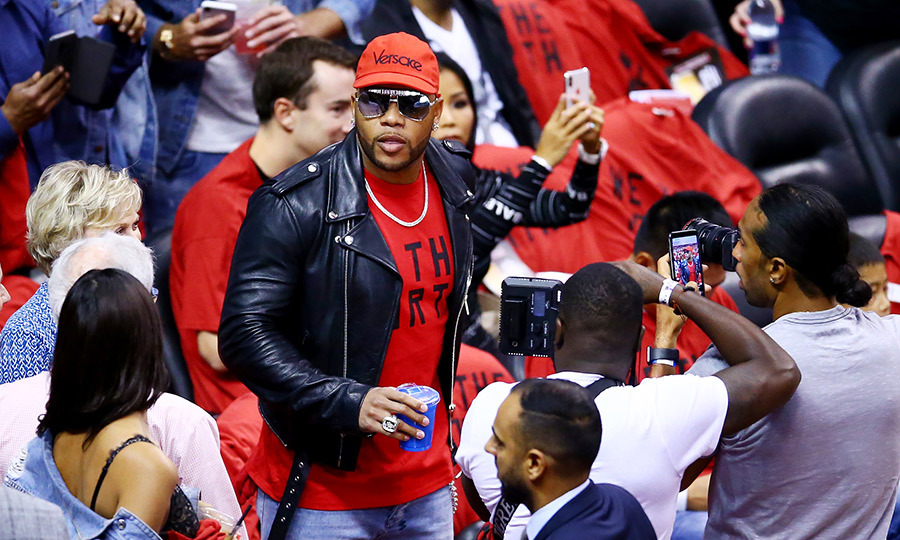 "Rapper <strong><a href=""/tags/0/flo-rida"">Flo Rida</a></strong> also showed up to Game 2, and he's a Raptors fan! The ""Low"" hitmaker wore a We The North shirt underneath his leather jacket. 