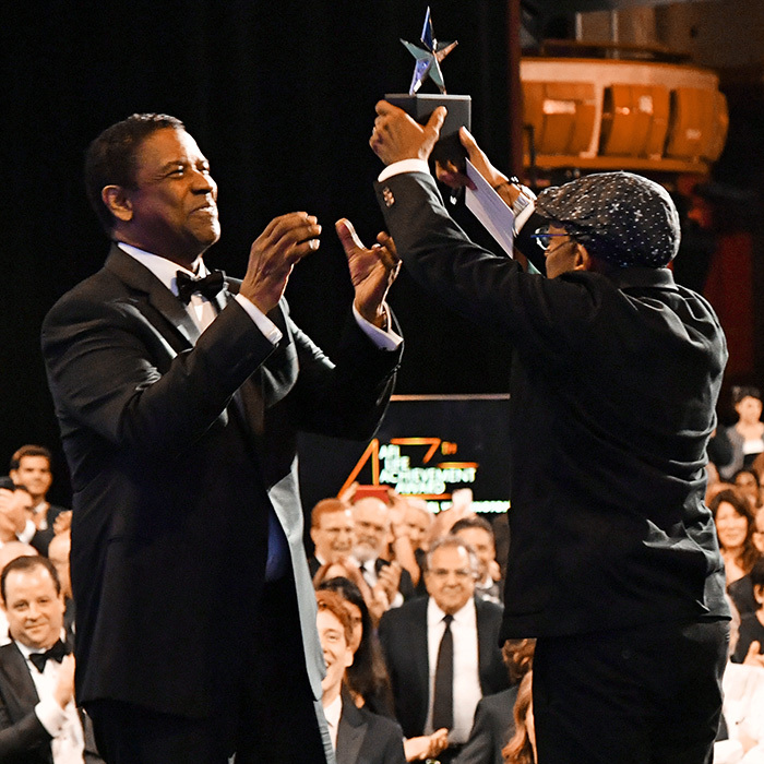 Congrats, Denzel! Filmmaker Spike Lee presented the actor with this lifetime achievement award.