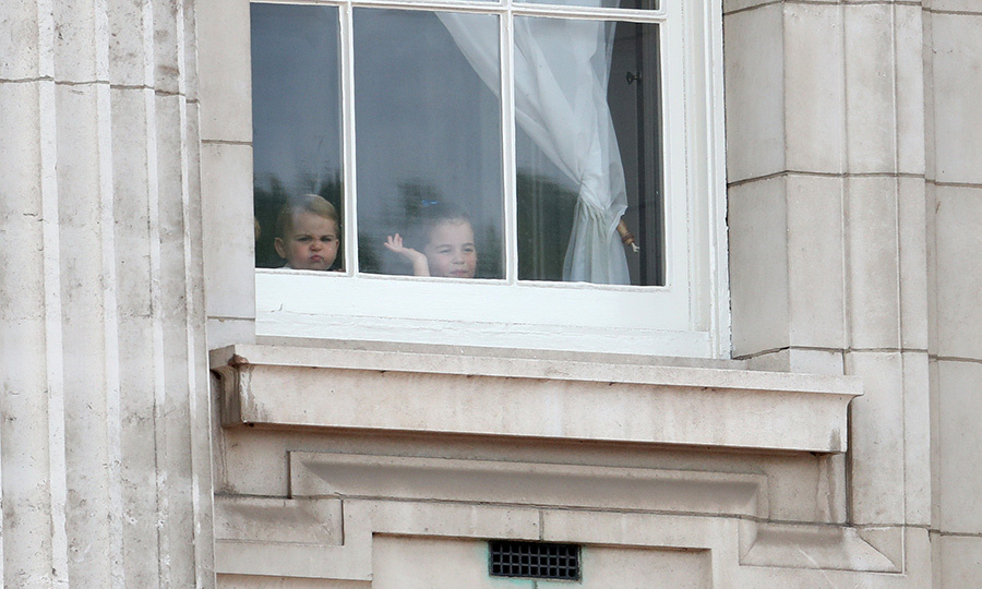 "Peekaboo! Two cheeky royals, including a very excited <strong><a href=""/tags/0/princess-charlotte"">Princess Charlotte</a></strong> peered out of a Buckingham Palace window, waiting for their balcony appearances as they watched the festivities outside. Poor <strong><a href=""/tags/0/prince-louis"">Prince Louis</a></strong> looked a bit grumpy, though! 