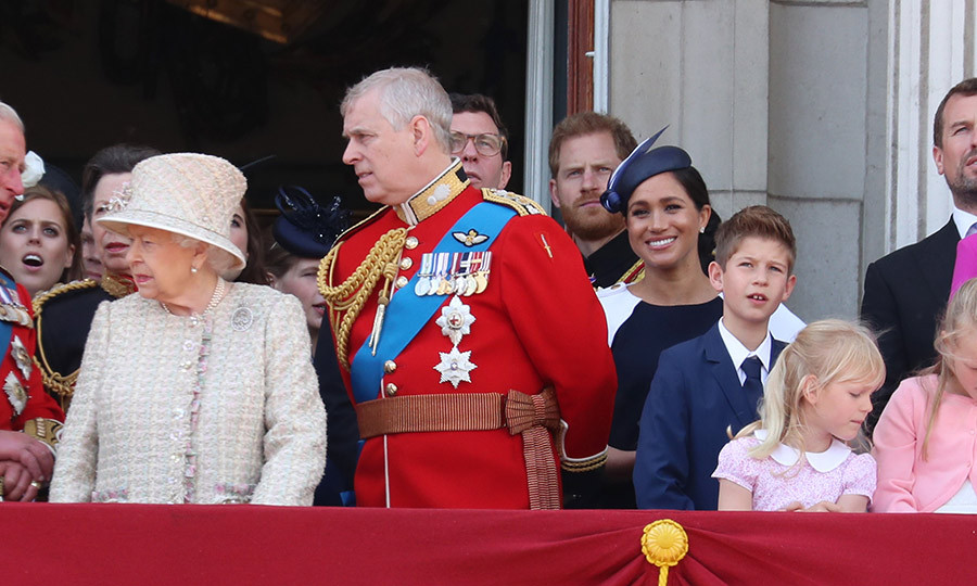 Some had thought Meghan was absent from the balcony for the flypast, but she was there, standing behind Andrew with Harry. 