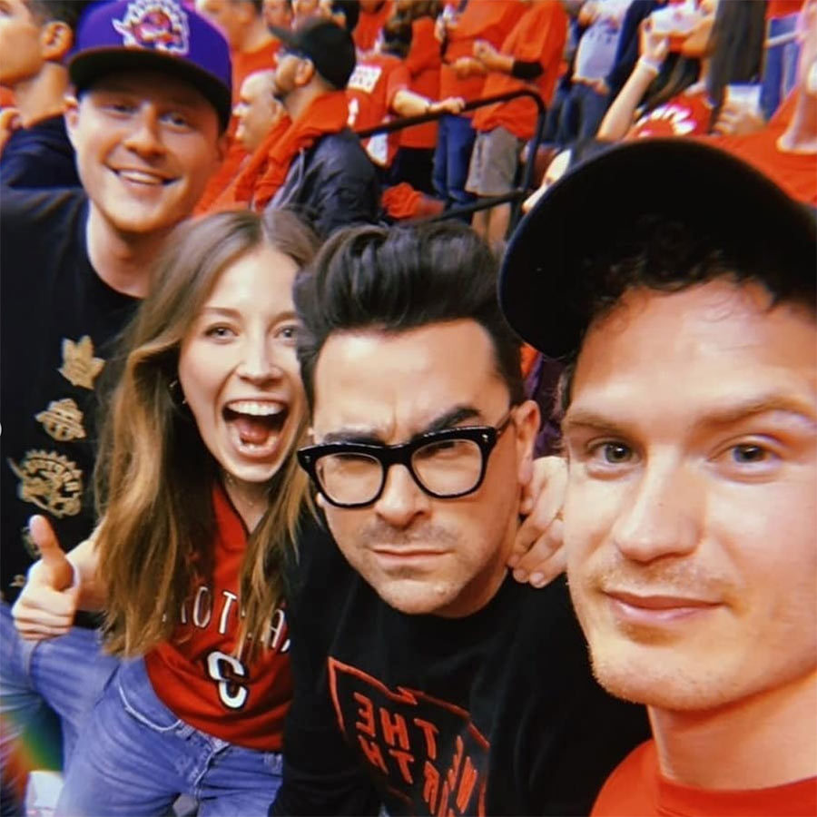 "Some of the cast of <strong><i><a href=""/tags/0/schitts-creek"">Schitt's Creek</i></strong></a> made it out to Game 5 between the Raptors and Warriors in Toronto! Unfortunately, the Raptors lost by a single point, but that didn't stop celebs from packing the stands to cheer them on, as they've been doing throughout the NBA Finals. 