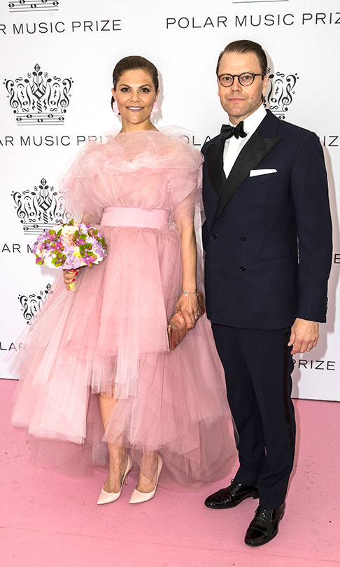 For the awards evening, Crown Princess Victoria stole the show in a breathtaking pink tulle gown by Selam Fessahaye. She paired it with blush pink heels and a matching clutch. Her husband, Prince Daniel, looked handsome in a tuxedo.