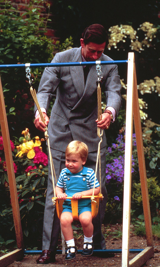 Doting dad Charles has always been heavily involved in both of his sons' lives. Here he is pushing William on a swing at Kensington Palace in 1984, just before William turned two! 