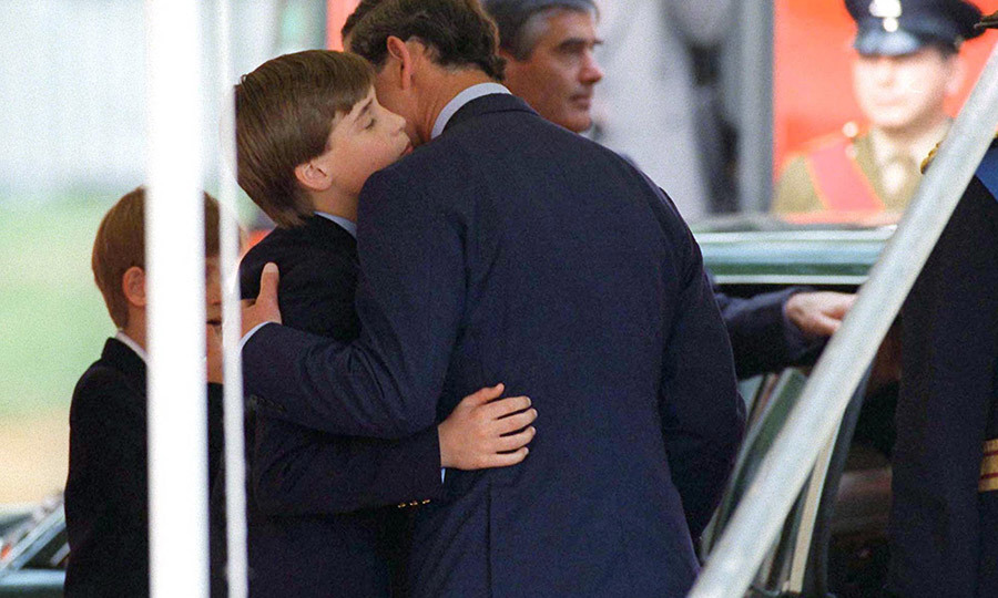 Charles has never been shy about showing his sons affection. Here he is hugging William goodbye at a V-E Day event in May 1995. 