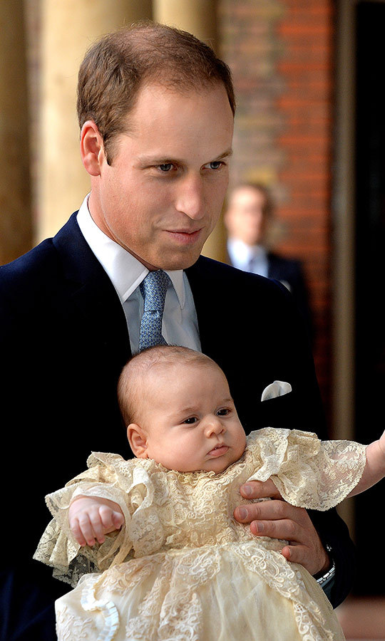Prince William looked so happy holding George at his christening in 2011! 