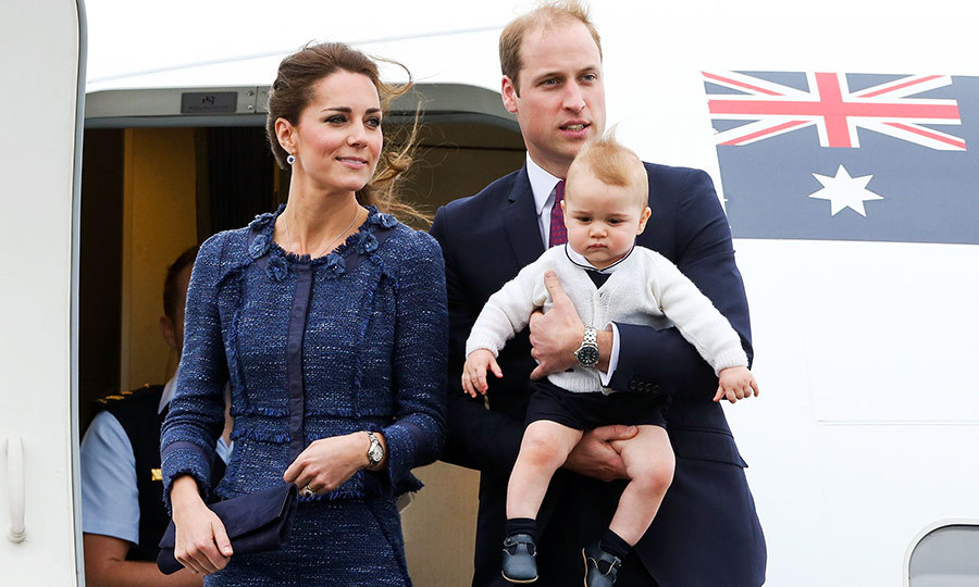 William looked completely adorable carrying George onto a flight from New Zealand to Australia during the Cambridges's tour down under in 2014. 