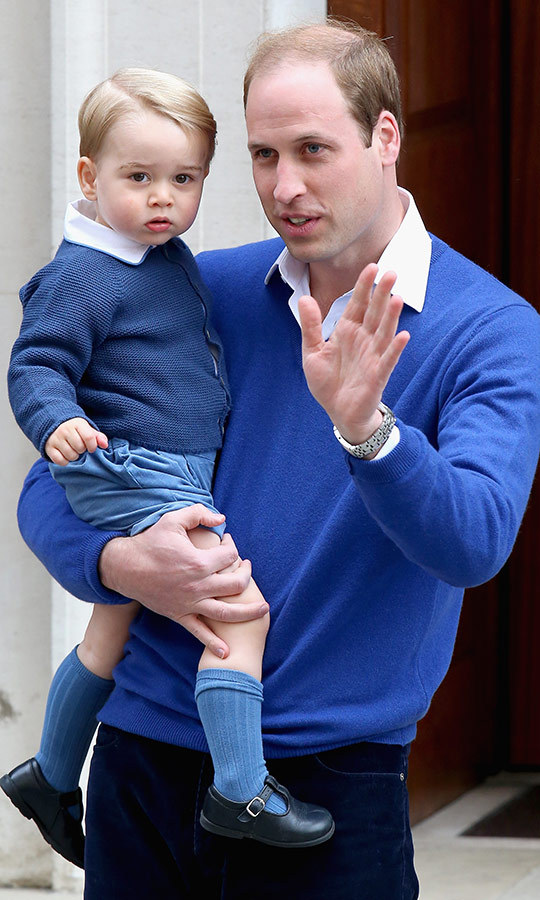 "Matchy matchy! George and his dad dressed in similar shades of blue when William took his son to meet newborn sister <strong><a href=""/tags/0/princess-charlotte"">Princess Charlotte</a></strong> at the Lindo Wing at St. Mary's Hospital in London in 2015. 