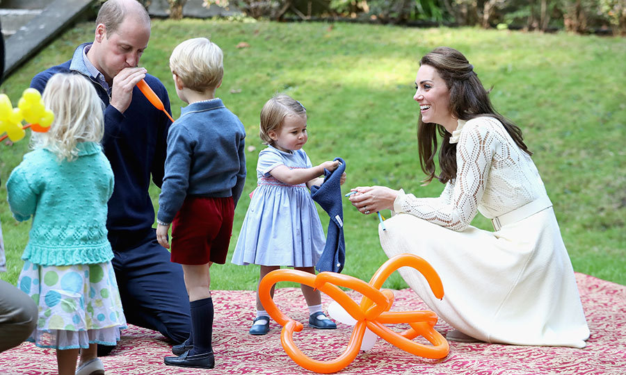 William charmed royal watchers everywhere when he helped George and Charlotte make balloons at a party in Canada in 2016! 