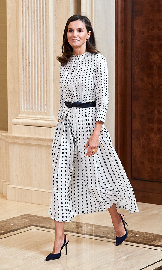 Queen Letizia of Spain looked perfect in black-and-white polkadots while attending several audiences at Zarzuela Palace on June 14. She paired the number with a thin belt to cinch in her waist and a pair of black slingback pumps.