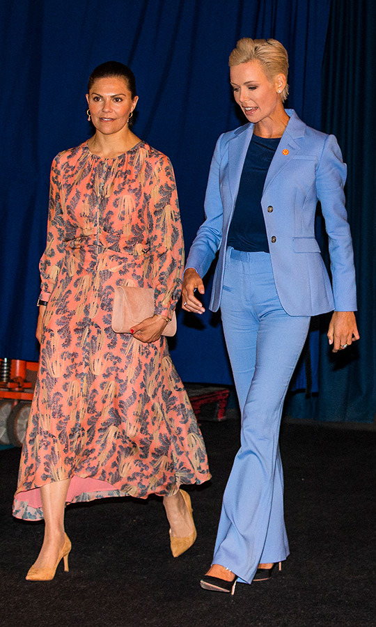 Crown Princess Victoria of Sweden joined Dr. Gunhild A. Stordalen at the EAT Stockholm Food Forum on June 13. For the educational day, the princess was the picture of spring in an orange printed dress and orange suede pumps. She carried a similarly hued clutch, as well.