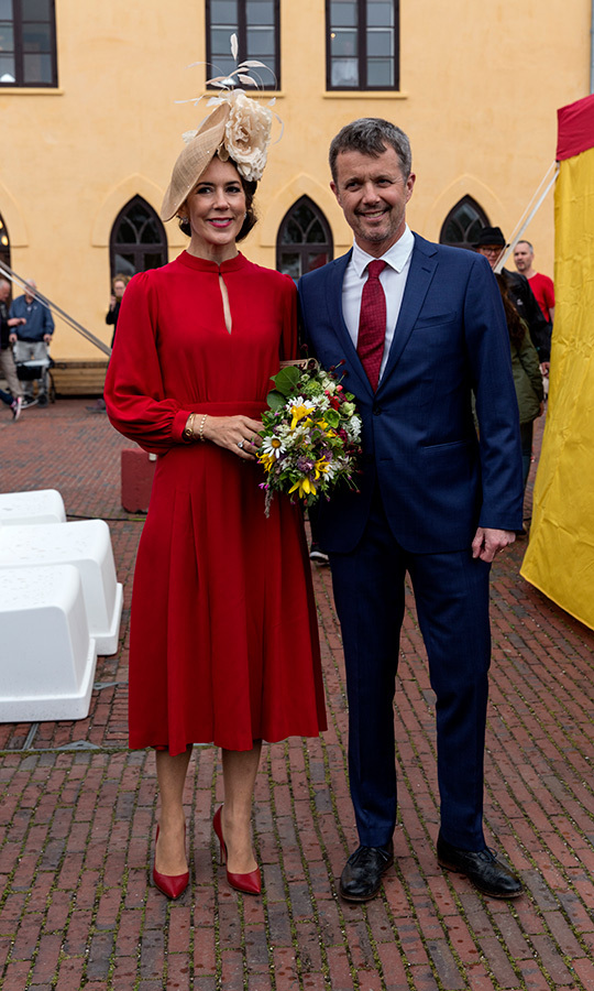 Crown Princess Mary joined her husband Crown Prince Frederik at the celebrations of the 800-year anniversary of the Danish flag on June 15. For the exciting occasion, Mary looked radiant in a red dress and pumps, topping off her look with a beige hat.
