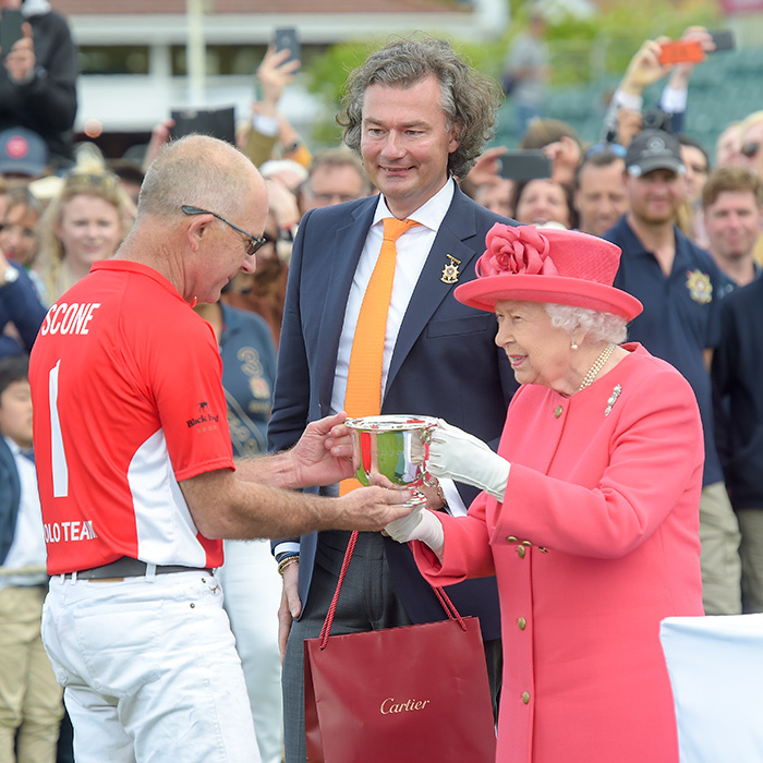 The Queen awarded polo player Laurent Feniou a Cartier gift and a trophy at the Cartier Queen's Cup Polo 2019 on June 16.