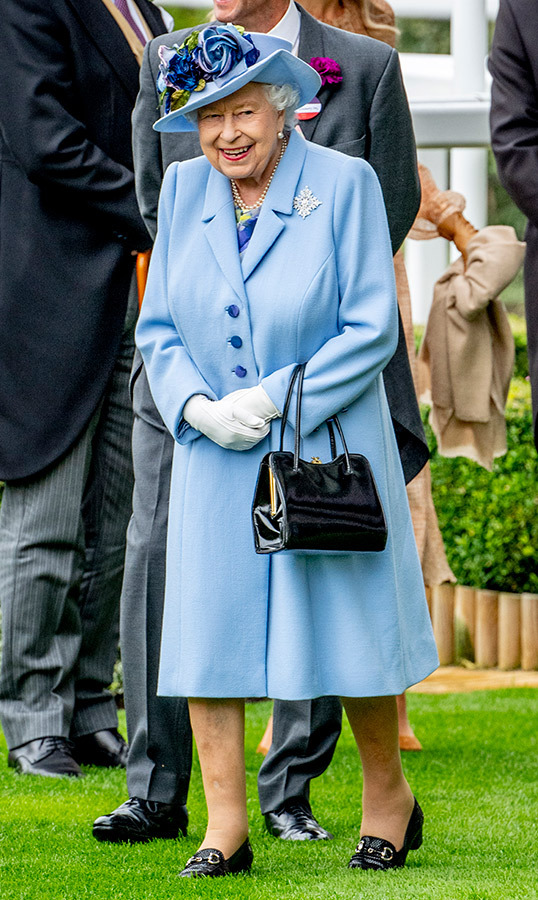 "June 18 was a stylish day for the Royal Family as they hit day one of the Royal Ascot! <a href=""/tags/0/queen-elizabeth-ii""><strong>Her Majesty</strong></a> dazzled in a beautiful periwinkle coat with a floral dress underneath. She anchored the look with her classic black shoes, accessorizing with white gloves, a patent black handbag and a beautiful blue topper.